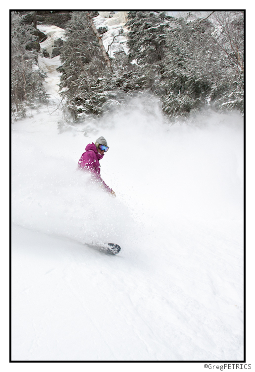 Christian snowboards through powder in VT