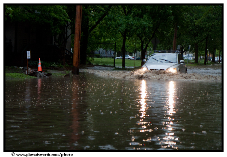 A car gets swamped on Booth Street in Burlington